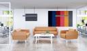 lobby with tan color sofa set