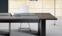 meeting table with walnut veneer and leather worktop