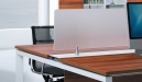 workstation desk with frosted acrylic screen on desktop
