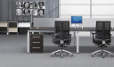 modular desking system in dark wood finish with frosted glass screen