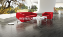 stylish lounge with wooden floor and red fabric sofa