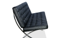 side view of two seater office sofa in black leather and steel frame