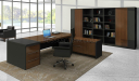 inside view of office table with drawers , side cabinet and black leather chair