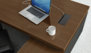 walnut veneer office tabletop with laptop and wirebox