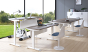 modern office furnished with various height adjustable desks
