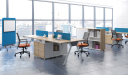 Office with workstations in light wood and chairs