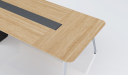 meeting table with oak wood table top and wire management