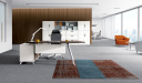 large office cabin with gray carpet and modern desk