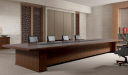classy boardroom with wooden table and leather chairs