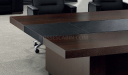 meeting table top in dark wood and black leather