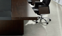 close up view of dark oak and leather conference table top