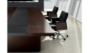 conference table in dark wood with black leather chairs