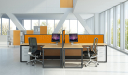 L shape workstations with orange color partitions