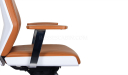 side view of tan leather office chair with a curved ergonomic backrest