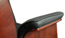 close up view of office chair armrest in black leather