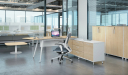 contemporary office with maple wood interiors and office desk