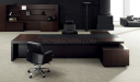 elegant office cabin with large table, rear storage unit and black leather chairs