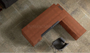 top view of L shape office desk in natural wood finish