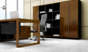 close up view of walnut finish office desk with black leather chair