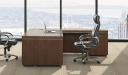 L shape office table in walnut with black leather chair