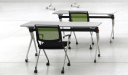 white training tables with green chairs