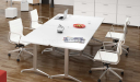 meeting room with white modular tables and chairs