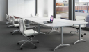 white laminate training tables with white leather chairs