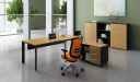 office cabin with L shaped office desk with orange chair