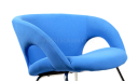 close up view of arm chair in blue fabric
