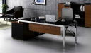 modern office desk with black glass top and steel legs