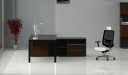 side view of black glass office desk with side cabinet