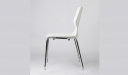 side view of white cafeteria chair with chrome legs