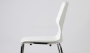 close up view of white cafeteria chair