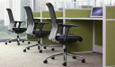 green workstation with black leather office chairs