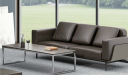 three seater office sofa in brown leather with center table