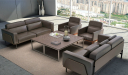 office lounge area with brown leather sofas