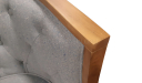 close up of arm chair in blue fabric and oak wood frame