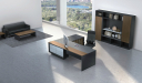 contemporary office space with large office table, chair and rear storage unit