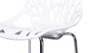 close up view of white cafeteria chair with laser cut pattern seat