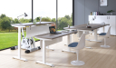 modern office furnished with various height adjustable desks