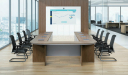boardroom with U shape conference table and black chairs