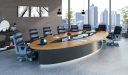 large boardroom with oval shape table and chairs