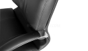 black leather office chair with padded armrests
