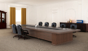 elegant boardroom with large meeting table & chairs